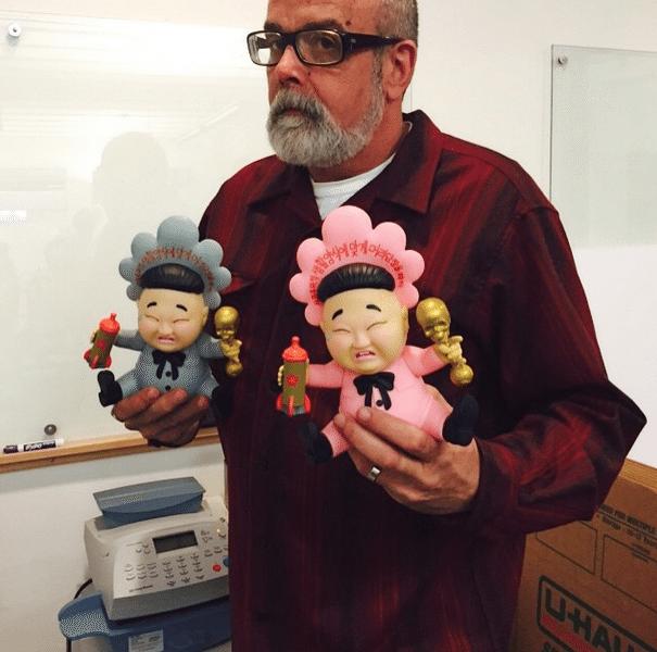 Baby Huey By Frank Kozik x Kidrobot in hand